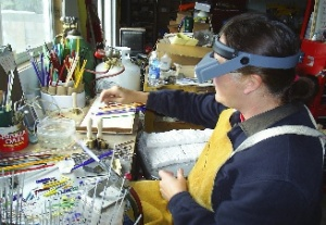 Irene making beads in her studio